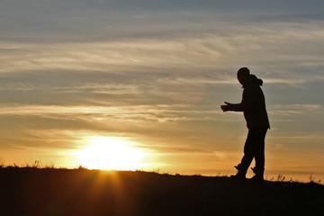Man on sunset background