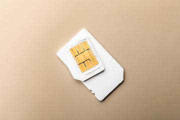 Sim card on color background