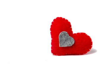 Felt red heart isolated on a white background