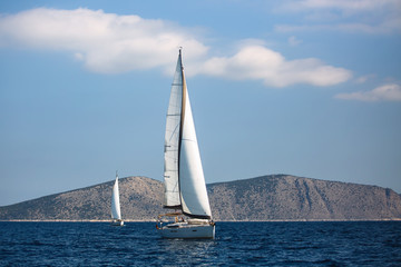 Wall Mural - Greece sailing yacht boat at the Aegean Sea. Luxury cruise yachting.
