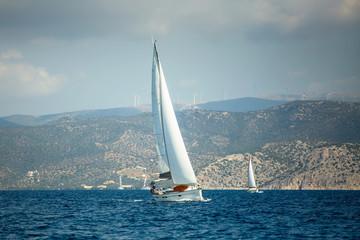 Fototapete - Sailing boats participate in sail yacht regatta in the Aegean Sea.