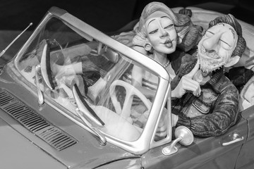 Christmas toy decoration. Couple in retro car