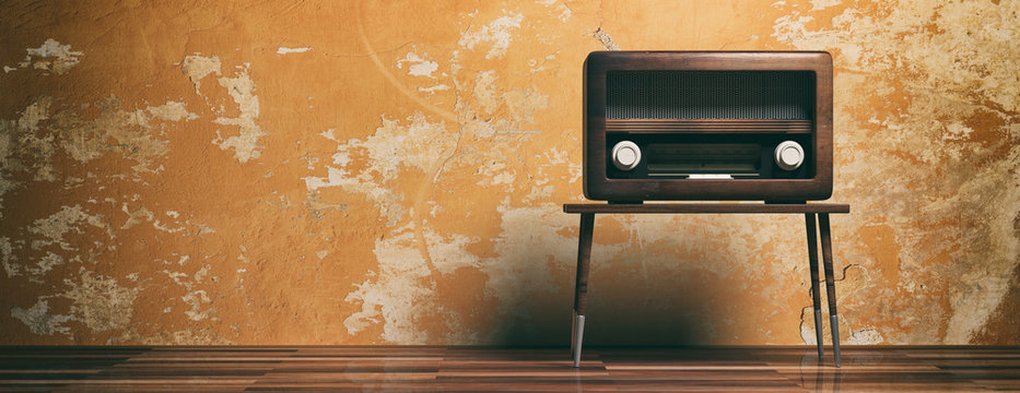 Radio old fashioned on wooden table, oarange wall background, banner, 3d illustration