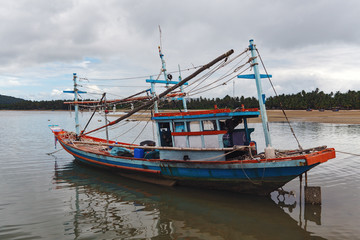 The old fishing boat during an outflow in Thailand.
