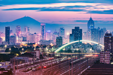 Cityscape and railway station at evening time. Shenzhen. China.