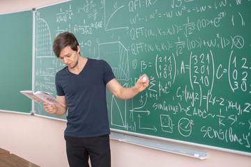 pupil doing homework on blackboard b