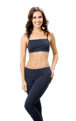 Full body of smiling woman in sportswear, isolated