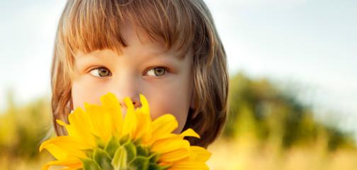 Happy boy with sunflower