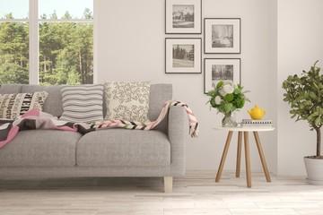 White stylish minimalist room with sofa and summer landscape in window. Scandinavian interior design. 3D illustration
