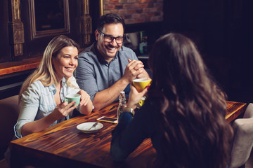 Beautiful happy friends enjoying their afternoon coffee - Image