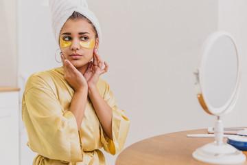 545b24120468 A closeup portrait of a beautiful woman after a bath with a towel on the  head