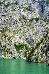 View of a boat in the lake in the  Koman Reservoir in Albania.