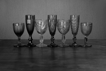 seven glasses for alcoholic drinks black and white photo