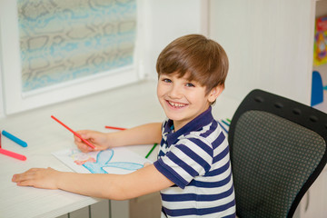 child draws at the table