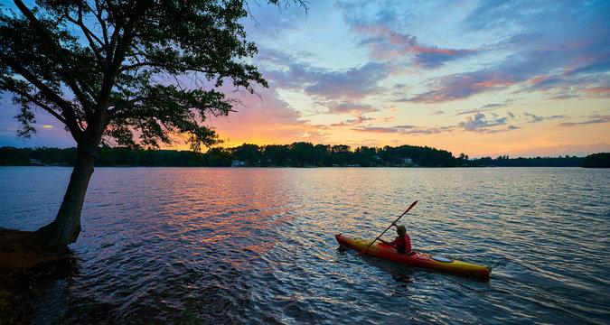 Female Kayaker on Lake Keowee at Sunset