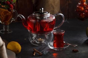 Red tea wooden background