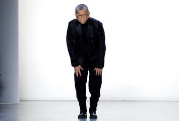 Designer Tadashi Shoji appears after the showing of his collection during New York Fashion Week in New York