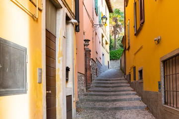 Beautiful picturesque and colorful old town street in Bellagio city, Como lake, Italy