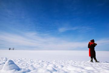 Girl on snowy field
