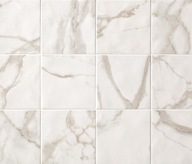 Light beige marble mosaic tiles texture background. Marble tiles with natural pattern.