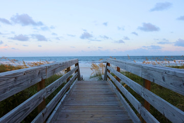 Beautiful landscape with way to the ocean beach. Wooden boardwalk and stairs to the Atlantic ocean beach over sand dunes in Huntington Beach State Park, Myrtle Beach area, SC, USA.