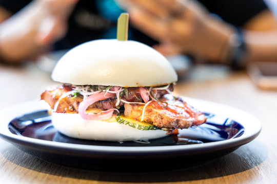 Delicious pork belly bao or Chinese burger served in restaurant