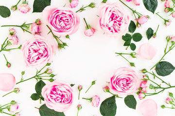 Floral round frame with roses flowers isolated on white background. Flat lay, top view. Valentines day concept