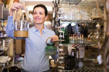 female holding glass jar