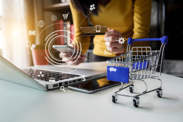 Obraz online shopping concept, woman shopping online is a form of electronic commerce from a seller over internet. - fototapety do salonu