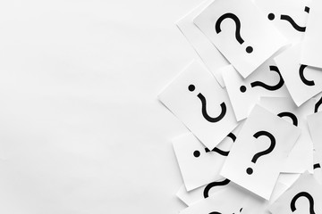 Pile of question marks printed on white cards