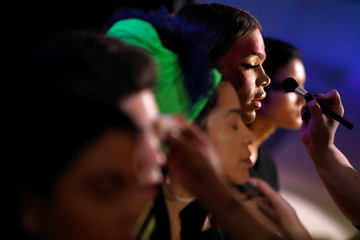 Models are prepared before the CHULO underwear show during the New York Fashion Week, which raised money for transgender and cisgender young women victims of violence, in New York