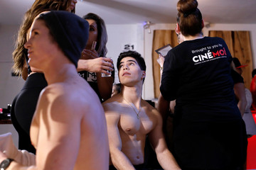 Models are prepared backstage before the CHULO underwear show during the New York Fashion Week, which raised money for transgender and cisgender young women victims of violence, in New York