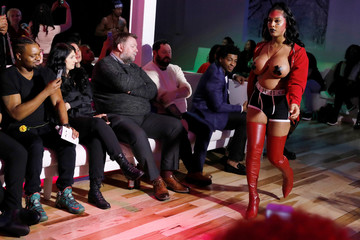 Transgender actress Aubrey Banks presents a creation from the CHULO underwear collection ahead of CHULO founder and lead designer Ricardo Muniz during the New York Fashion Week in New York