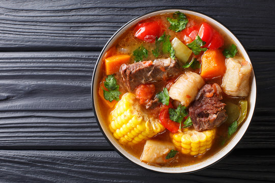 Sancochois a meats and vegetables stew, enjoyed in Latin America and the Spanish Caribbean islands close-up on a bowl. Horizontal top view