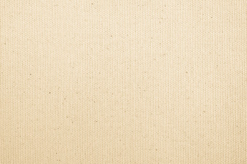 Calico fabric cloth texture background in light cream beige color