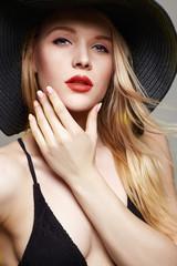 Beautiful young woman in hat. summer fashion