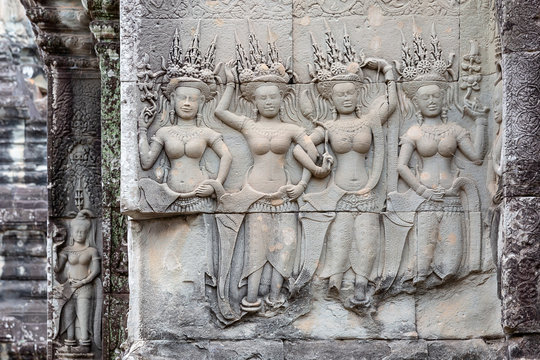 stone carving of Apsaras on a wall, Angkor Wat, Siem Reap, Cambodia, Asia
