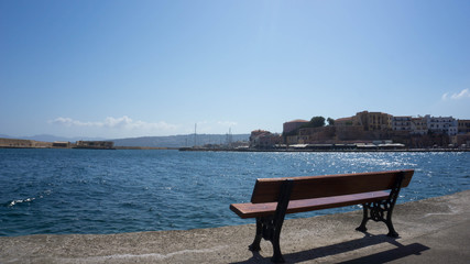 Bench in romantic scenery  at the Port of Chania Crete