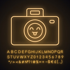 Smiling photo camera neon light icon