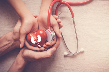 hands holding red heart with stethoscope, world kidney day