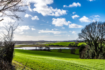 View of the winter flooded Combe Valley and Crowhurst Lake in East Sussex, England