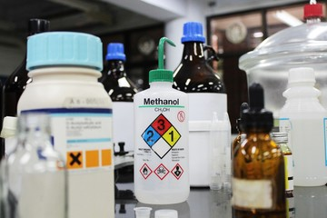 Bottle of Methanol and chemical with hazard symbols for experiment in Laboratory.