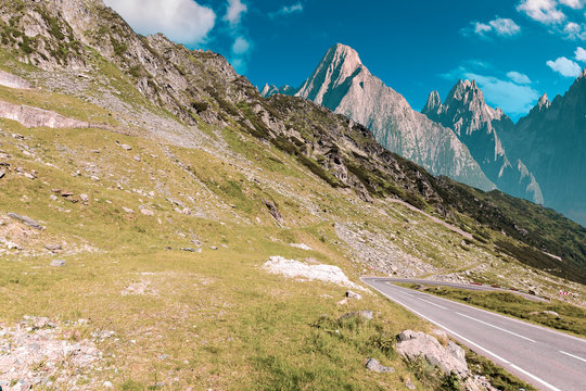 road through mountains with rocky cliff. summer travel concept. composite image with creative toning