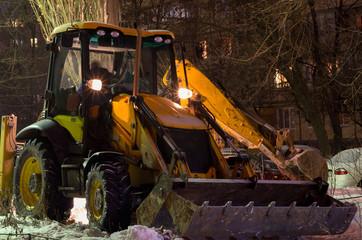 excavator snow cleaning night