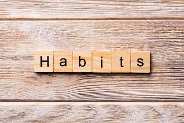 HABITS word written on wood block. HABITS text on wooden table for your desing, concept