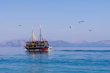 Sightseeing boat with passengers in the sea, Kuşadası Turkey