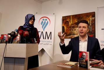 Hatice Cengiz, Turkish fiancee of slain Saudi journalist Jamal Khashoggi, and writer Ersoy attend a news conference to present a book on Khashoggi in Istanbul