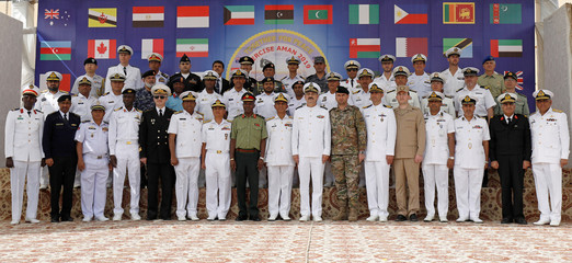 Commander Pakistan Fleet, Vice Admiral Amjad Khan Niazi and Naval commanding officers of participating countries pose for a photo during the opening ceremony of Pakistan Navy's Multinational Exercise AMAN-19, in Karachi