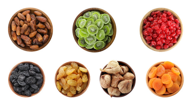 Set of different bowls with delicious dried fruits on white background, flat lay