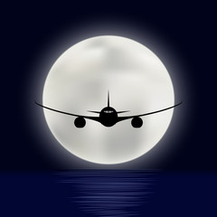 Flight of the plane over the sea on the background of a bright moon